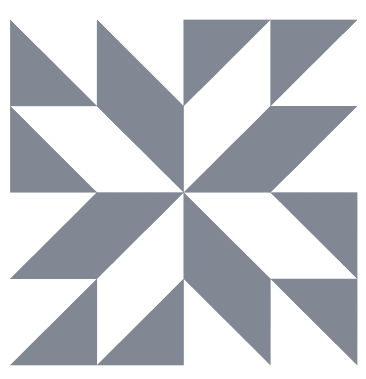 A grey and white Star Flower Quilt Block