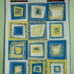 Quilt: Blue, Yellow, and White Wonky Log Cabin