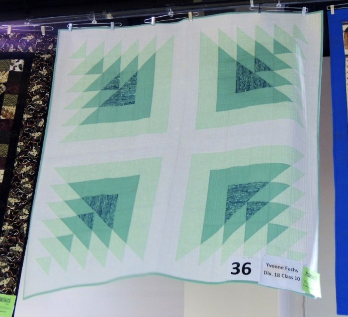 Triangle Transparency on DisplayImprov Rainbow Scrap Quilt