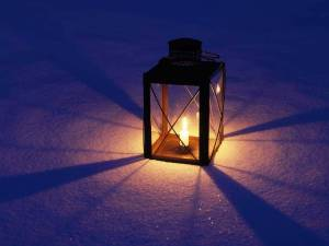 Lit Lantern in Snow