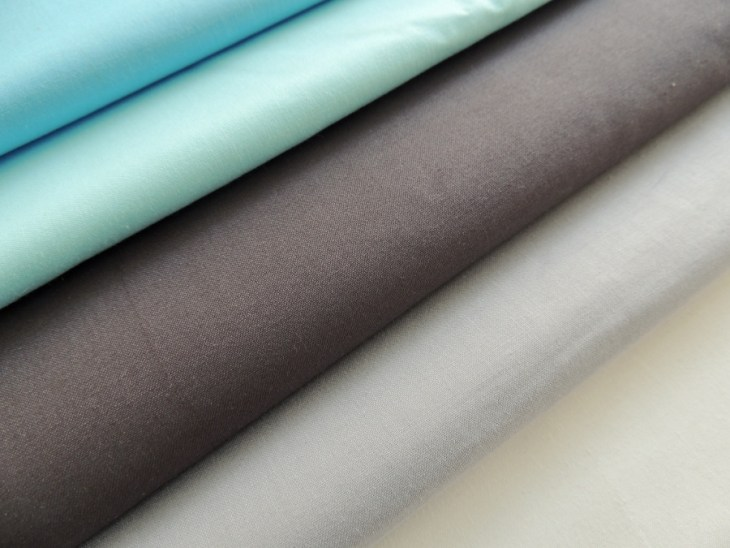 Michael Miller Cotton Couture (L to R): Wave, Sky, Charcoal, Fog, Bright White