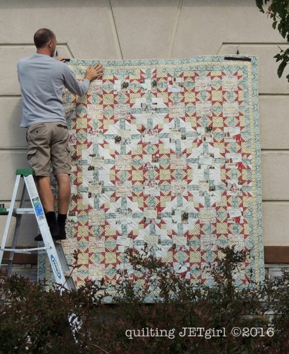 Hanging the quilt with care...
