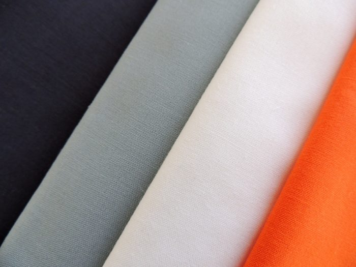 Downstream Fabrics: Kona Charcoal, Shale, Snow, and Carrot