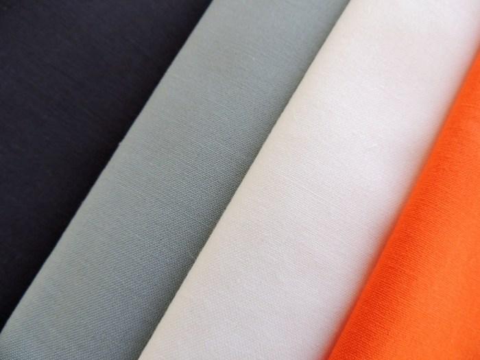 Downstream Fabrics: Kona Charcoal, Shale, Snow, and Carrot