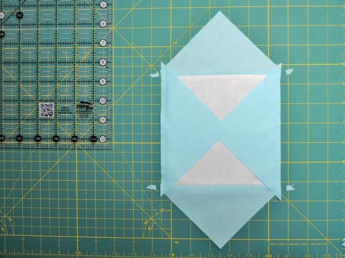 Square in a Square Tutorial - Trim Dog Ears Prior to Pressing Seams Three and Four