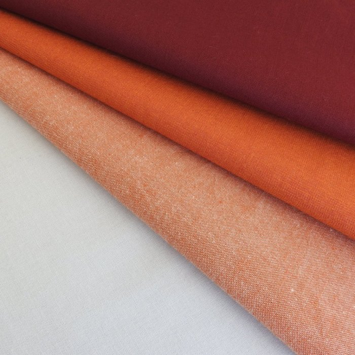 Fabric Selection: Kona Cotton Silver, orange and white cross weave, orange and yellow cross weave, maroon Denyse Schmidt solid