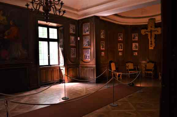 The dark paneled study and contemplation room