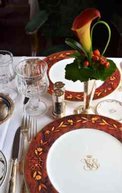 The tables are set with fine china, silver and crystal