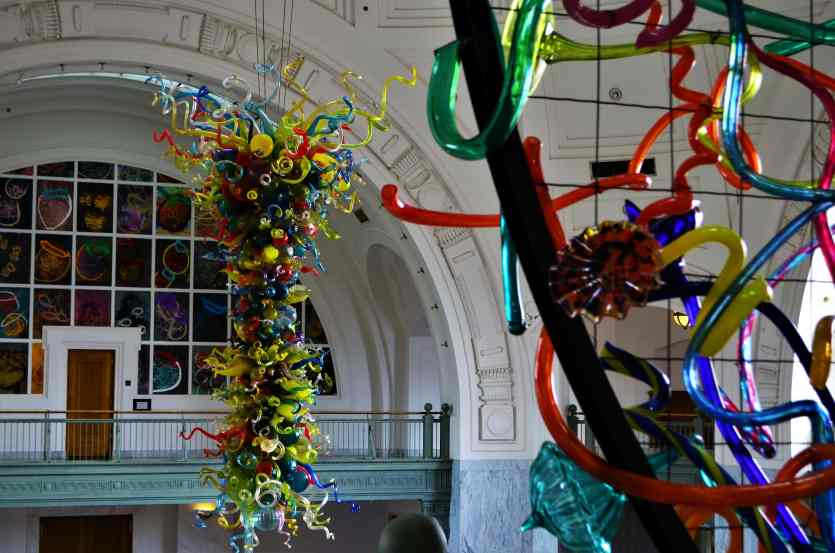 Lakawanna Ikebana in the foreground, the Chihuly chandelier hanging in the middle of the lobby and The Basket Drawing Wall in the background