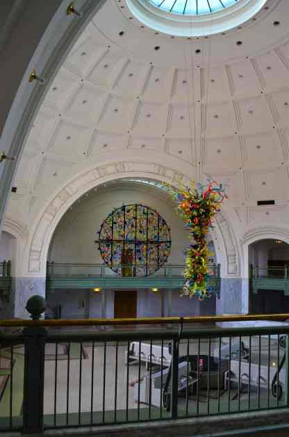 The End-of-the -Day chandelier floats in the high domed lobby of Tacoma's Union Station. In the background is Lakawanna Ikeban.