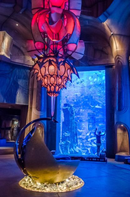 Imaginative artifacts from Atlantis augment a view into the aquarium