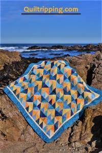 The front of my California Dreamin quilt #quilt #californiaquilt #halfsquaretrianglequilt