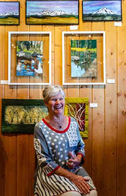June Jeager and a few of her many art quilts