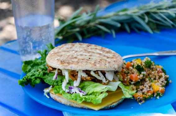 pulled pork sandwich with quinoa salad
