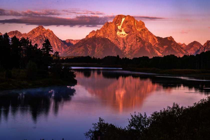 Sunrise flow on Mount Moran from Oxbow Bend overlook