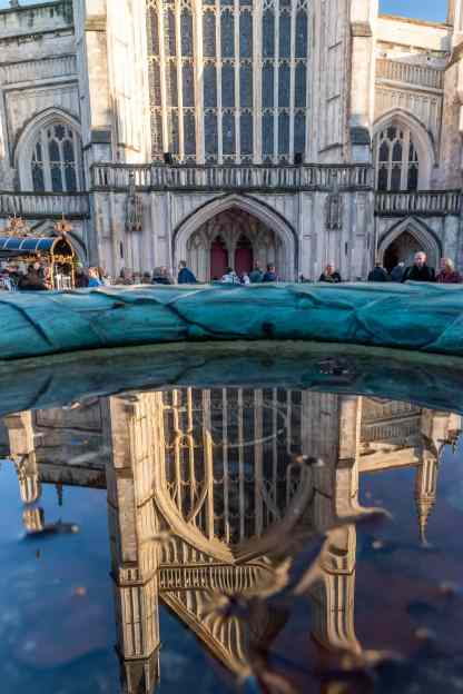 Reflection of the Winchester Cathedral in a fountain