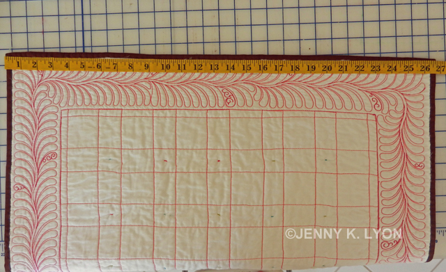 Measuring for the length of the quilt hanging sleeve