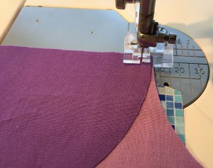 Fabric patches lined up under the presser foot