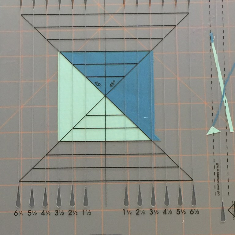 Half square triangle unit and trimming ruler