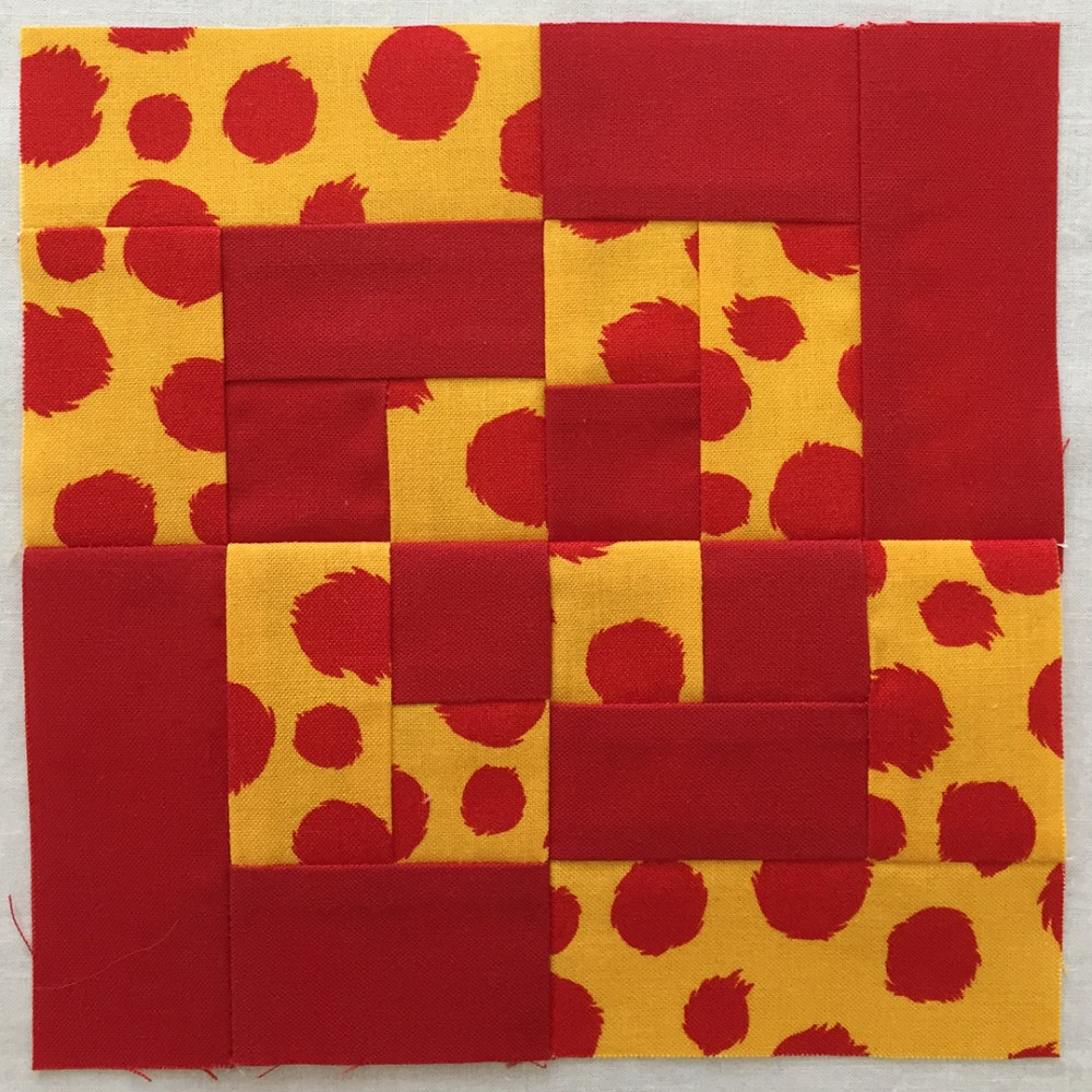 quilt block in red and yellow