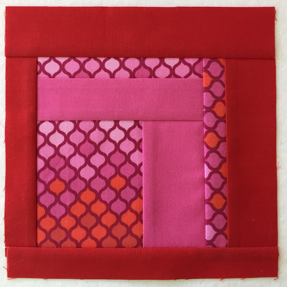 quilt block in red and pink