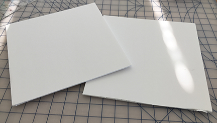 Two pieces of foam board