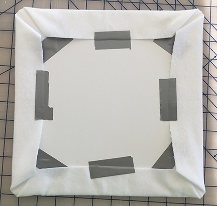 All four sides of the flannel taped behind the foam board