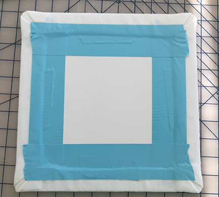 The back of a board taped with light blue duct tape