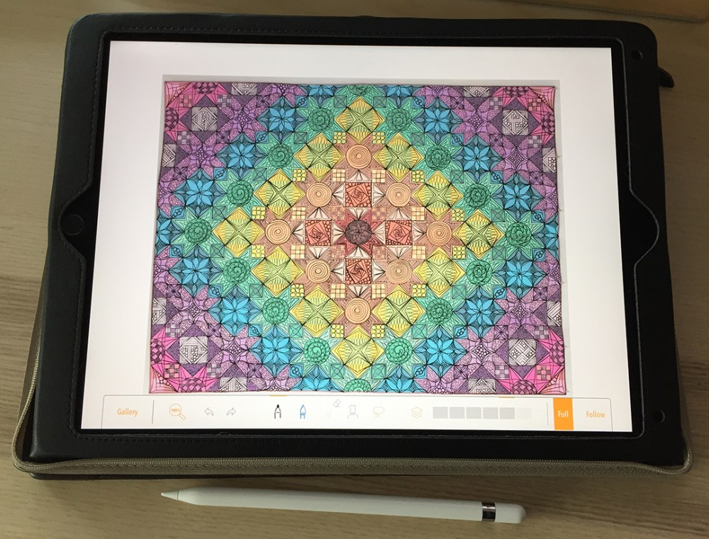 photo of an iPad showing a photo of a quilt top with a quilting design drawn over it