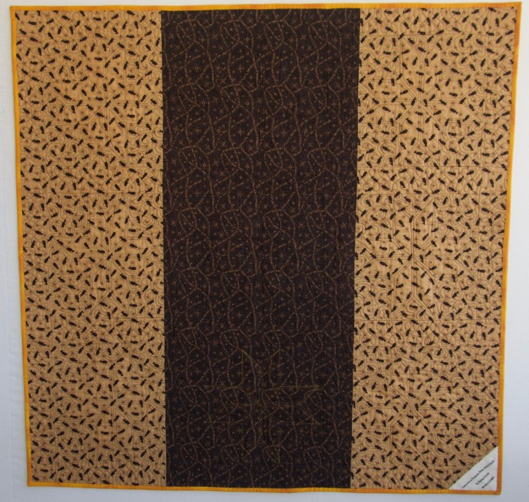 Black and tan quilt back