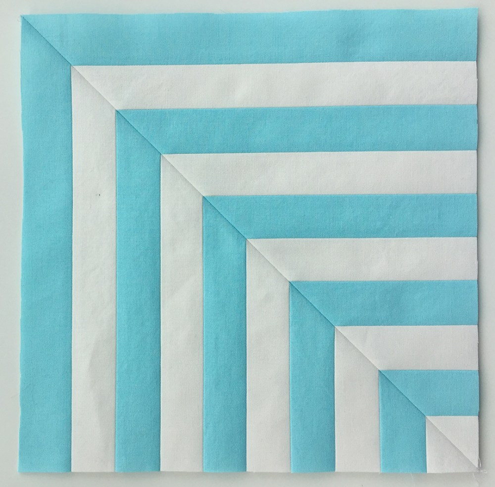 one quilt block with blue and white angled lines