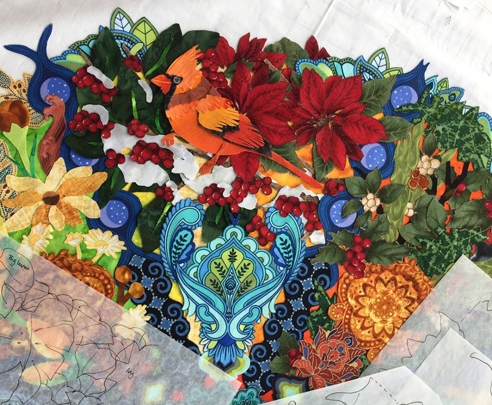fabric collage of cardinal, berries, snow, and foliage