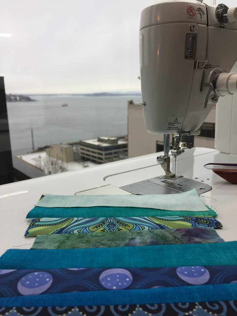sewing machine and pieces of blue fabric