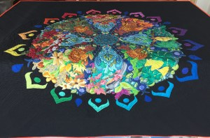 photo of a completed quilt draped over a table