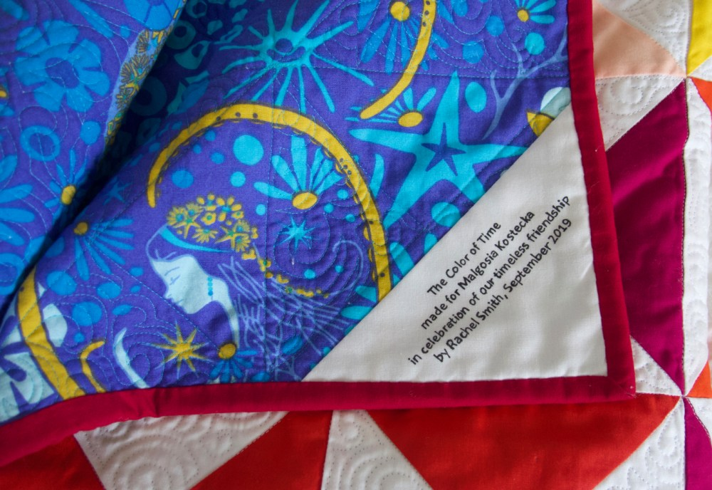 detail of quilt label with recipient's name