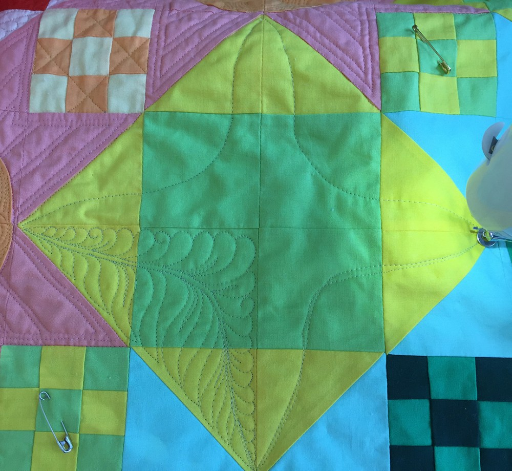 one quarter of the block has been quilted