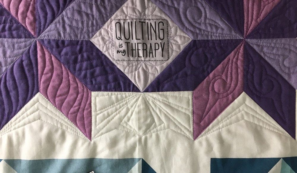 geometric quilting in white space between quilt blocks