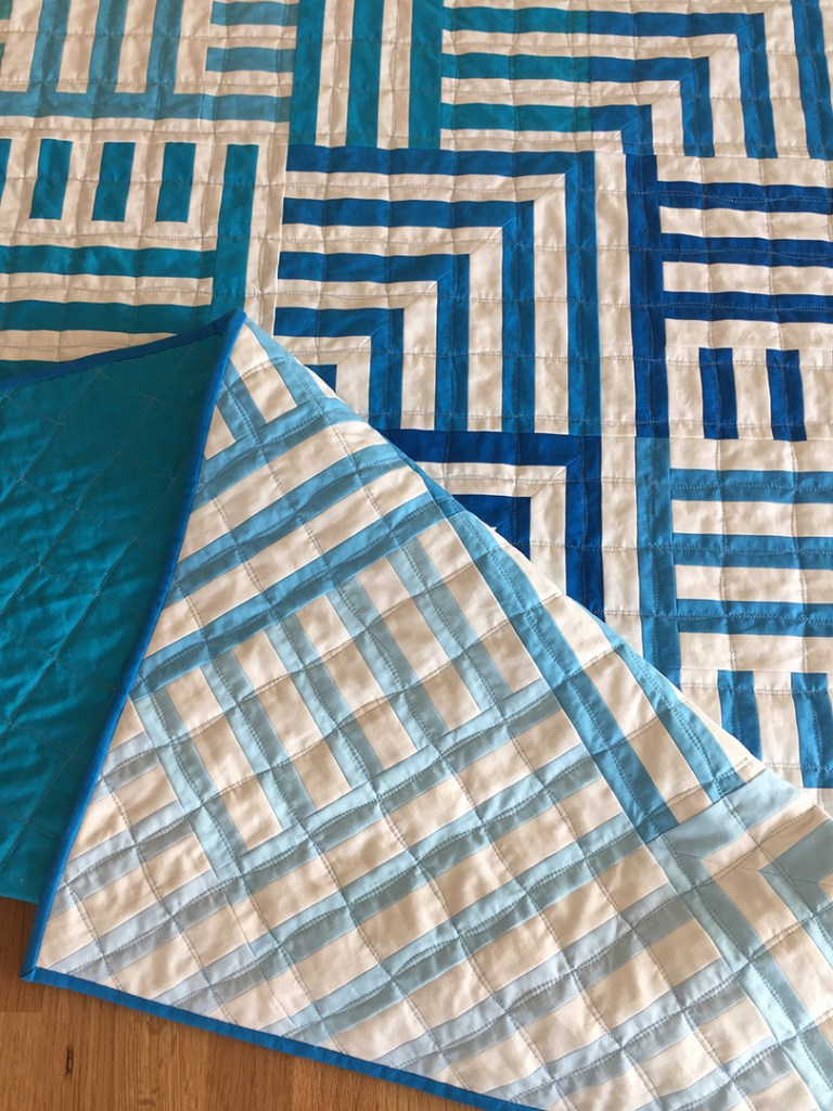 a blue and white striped quilt