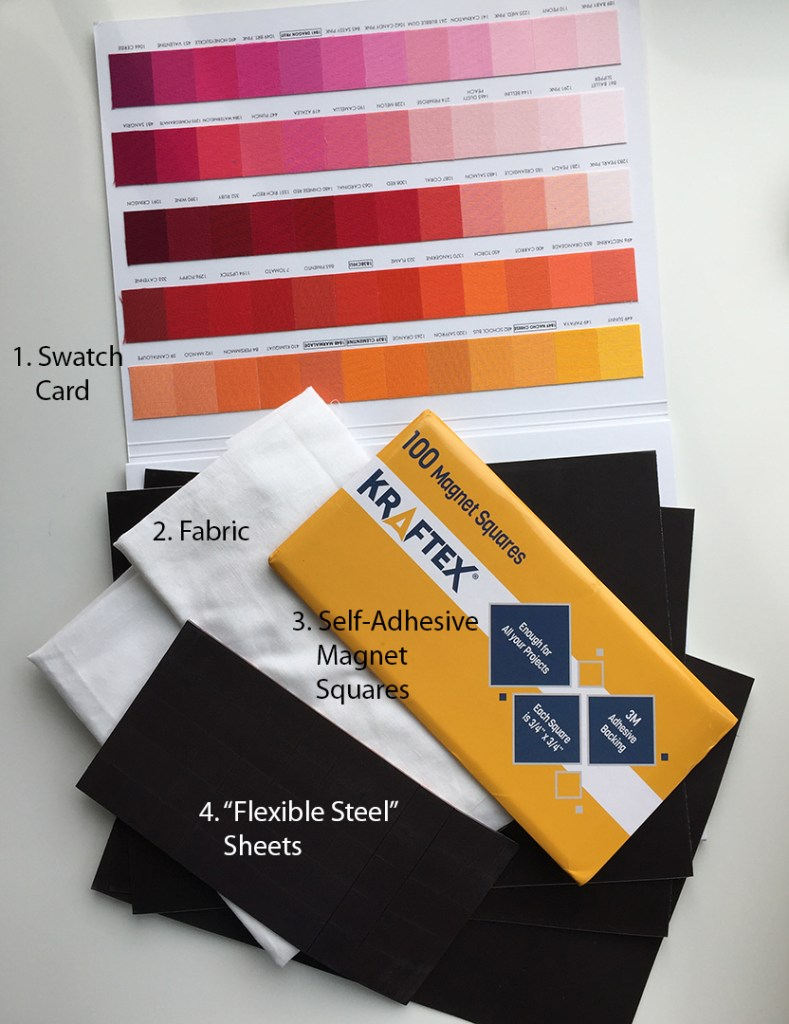 a fabric swatch color card, a pack of small square self-adhesive magnets, some folded white fabric, and some flexible magnetic sheets