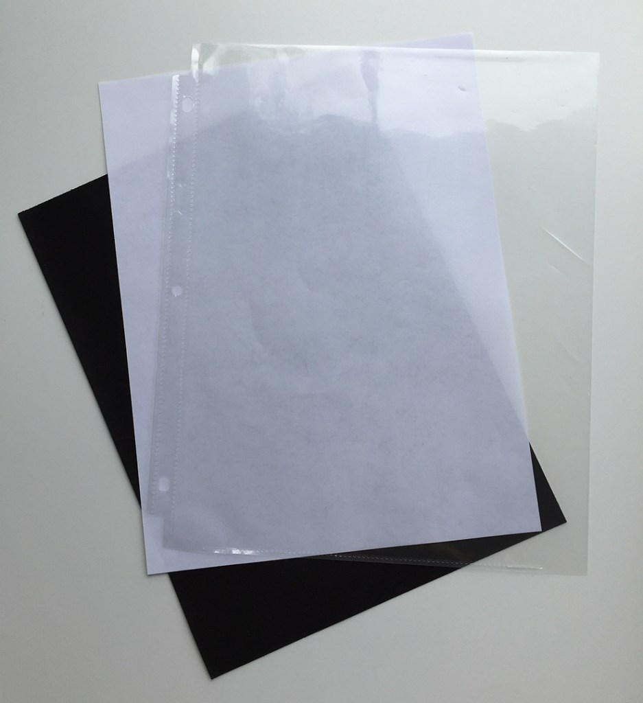 A flexible steel sheet, a piece of copy paper, and a clear page protector for a 3-ring binder