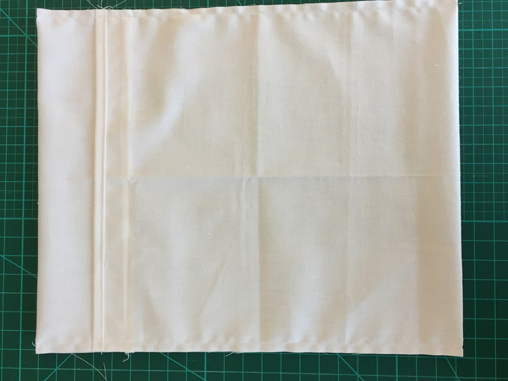 a fabric envelope, stitched along both sides but not yet turned right side out