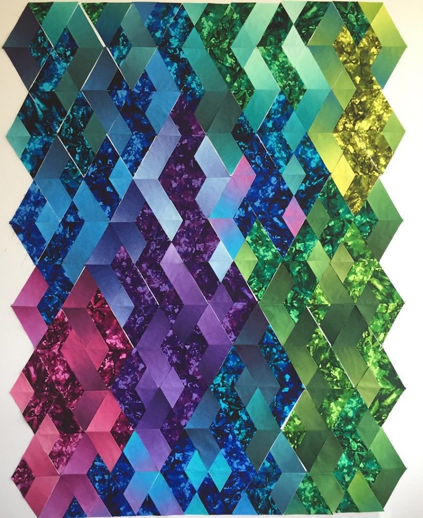 Diamond quilt blocks on a design wall
