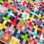 Rainbow Scrappy Charming Plus Quilt