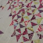 Dancing Quarter Square Triangle Quilt