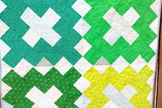 scrappy green baby quilt