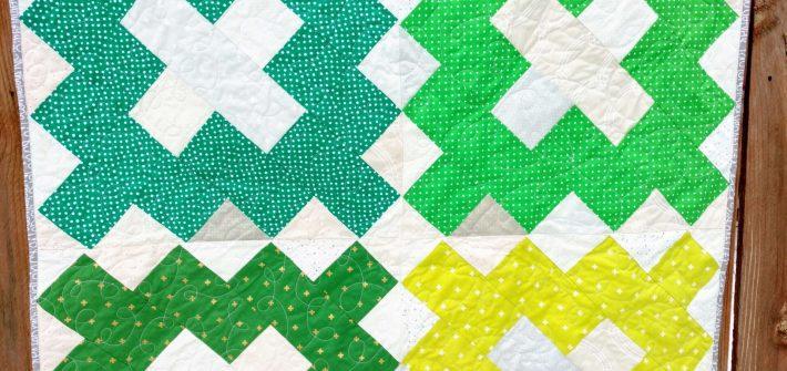 scrappy green baby quilt
