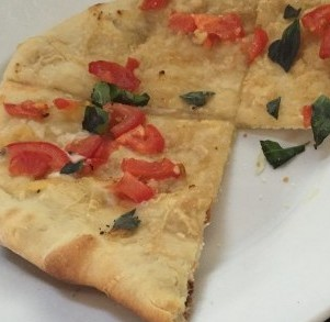 flatbread with tomato, garlic and basil
