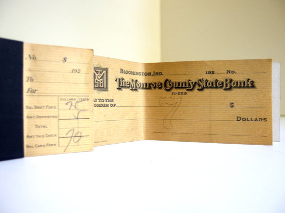 This vintage 1928 checkbook is available on Etsy.  My first checkbook in 1978 looked a lot like this one.
