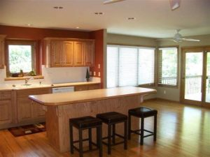 The kitchen island and too small dining zone
