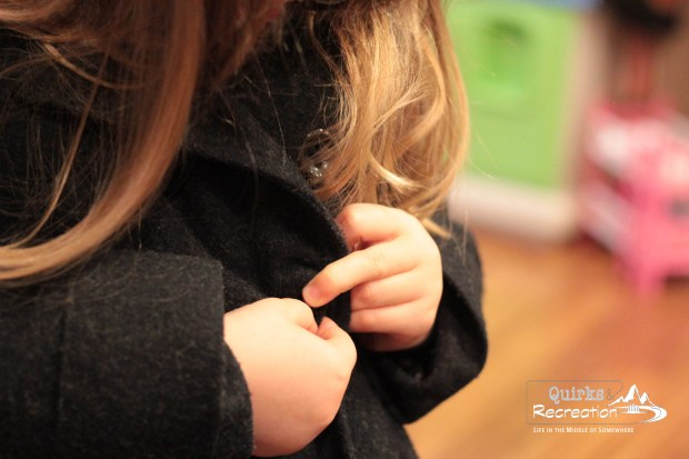 buttoning coat -- allowing indepedence